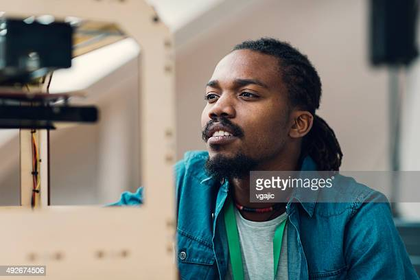 Designer Looking At 3D Printer Working.