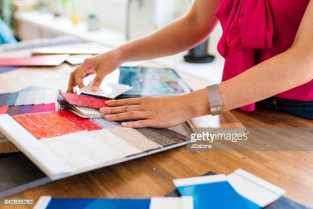 Designer looking at colour swatches