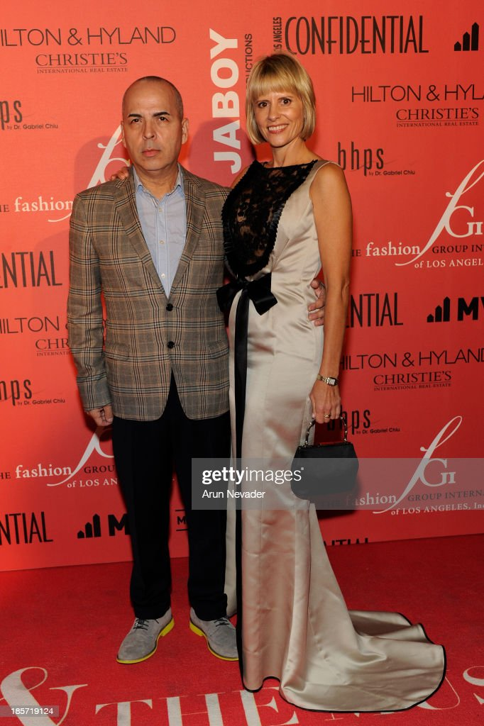 Designer Louis Verdad and FGI Co-Director Leanna Lewis arrive at the 5th Annual Designer & The Muse Hosted By Kathy Hilton at Mr. C Beverly Hills on October 23, 2013 in Beverly Hills, California.