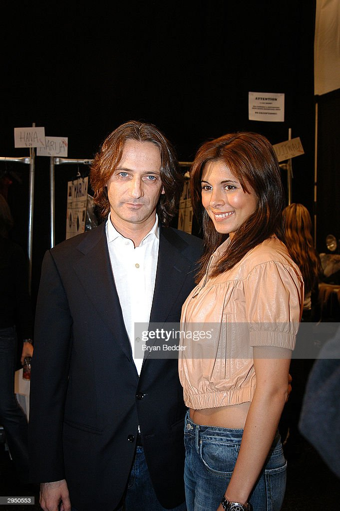 Designer Luca Luca poses with Jamie Lynn DiScala backstage at the Luca Luca fashion show at Bryant Park during the Olympus 2004 Fall Fashion Show February 8, 2004 in New York City.