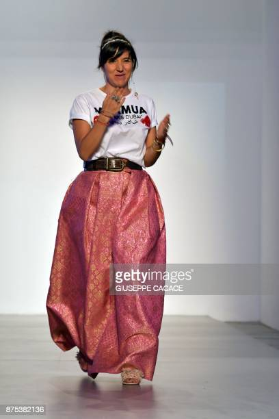 Designer Ludovica Virga of MUA MUA Dolls acknowledges the audience after presenting her creations during the Arab Fashion Week in the United Arab...