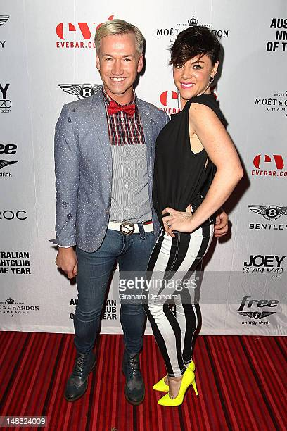Designer Lyndon Mcgauchie and TV personality Em Rusciano arrive at the Chris Judd launch party at Eve Bar and Lounge on July 14 2012 in Melbourne...