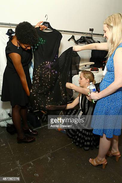 Designer Maddy Maxey poses with the LED Made with Code dress backstage at the ZAC Zac Posen SS16 NYFW show in partnership with Google Made With Code...