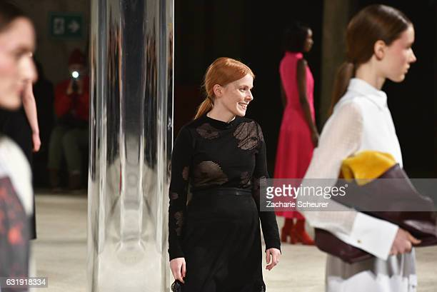 Designer Malaika Raiss acknowledges the applause of the audience at the Malaikaraiss show during the MercedesBenz Fashion Week Berlin A/W 2017 at...