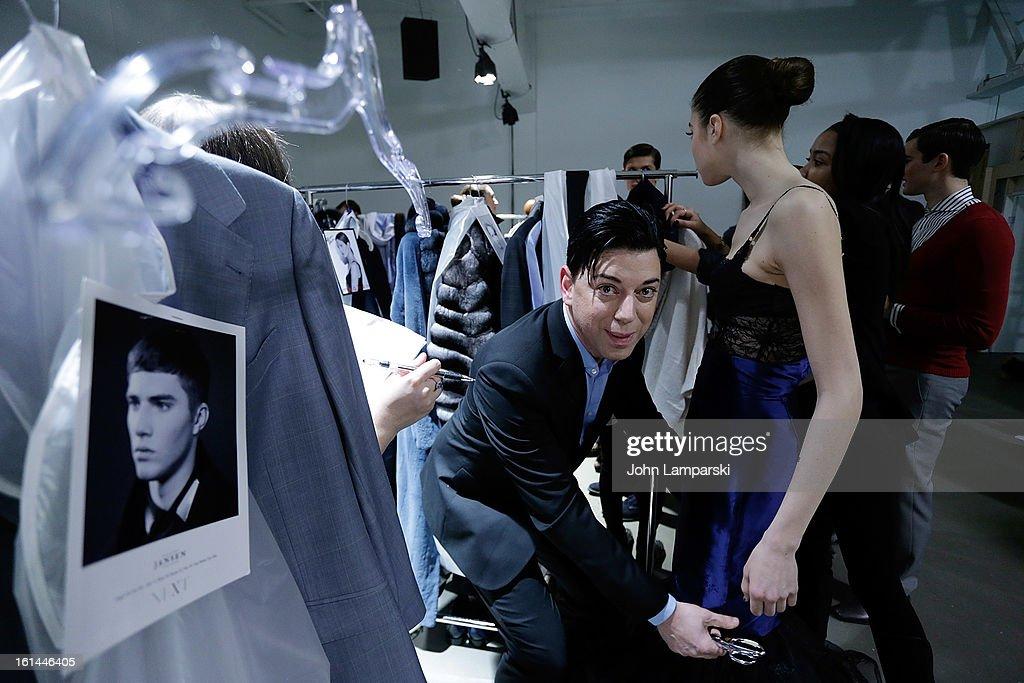 Designer Malan Breton prepares models backstage at the Malan Breton during Fall 2013 Mercedes-Benz Fashion Week>> at Pier 59 Studios on February 10, 2013 in New York City.