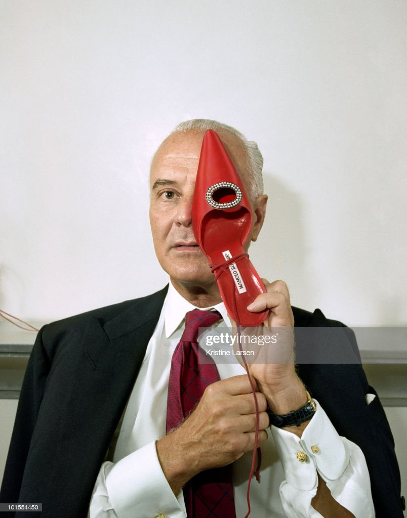 Designer Manolo Blahnik poses for a portrait session in 2002 for New York Magazine.