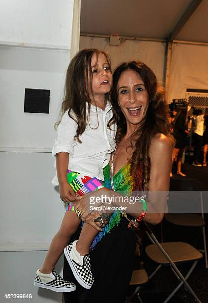 Designer Mara Hoffman and her son Joaquin Pinon pose backstage at the Mara Hoffman Swim fashion show during MercedesBenz Fashion Week Swim 2015 at...
