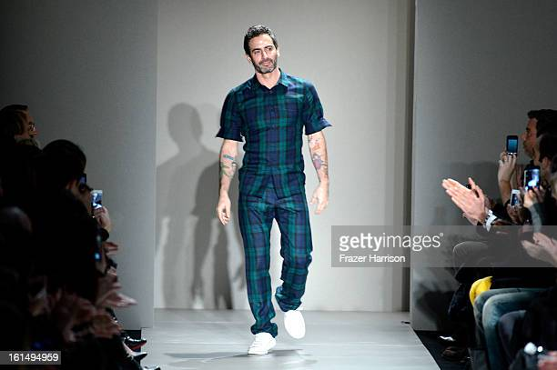 Designer Marc Jacobs appears on the runway after the Marc By Marc Jacobs Fall 2013 fashion show during MercedesBenz Fashion Week at The Theatre at...