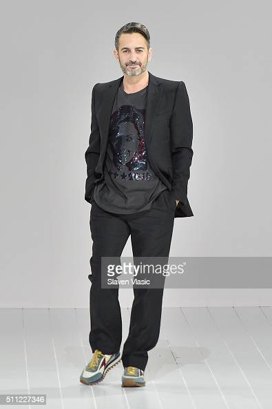 Designer Marc Jacobs greets the audience from the runway at Marc Jacobs Fall 2016 during New York Fashion Week at Park Avenue Armory on February 18...