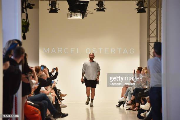 Designer Marcel Ostertag acknowledges the applause of the audience at the Marcel Ostertag show during the MercedesBenz Fashion Week Berlin...