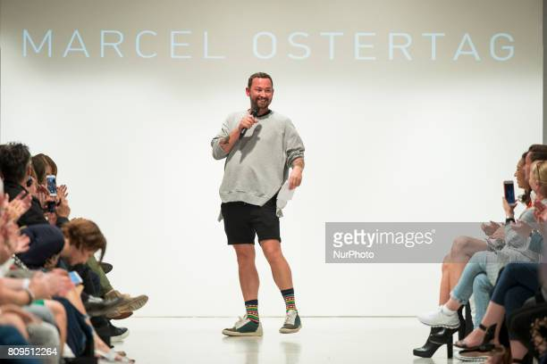 Designer Marcel Ostertag acknowledges the applause of the guests at the end of his Spring/Summer 2018 fashion show at Delight Rental Studios in...