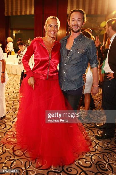 Designer Marcel Ostertag and model Natascha Ochsenknecht attend the Marcel Ostertag fashion show at Charles Hotel on July 24 2013 in Munich Germany