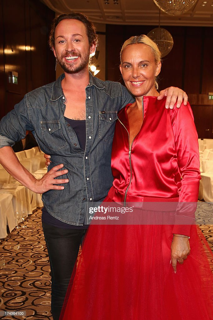 Designer Marcel Ostertag and model Natascha Ochsenknecht attend the Marcel Ostertag fashion show at Charles Hotel on July 24, 2013 in Munich, Germany.