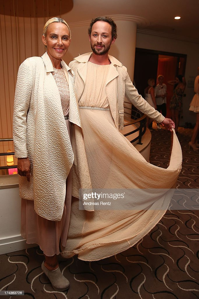 Designer Marcel Ostertag and model Natascha Ochsenknecht prepare backstage prior to the Marcel Ostertag fashion show at Charles Hotel on July 24, 2013 in Munich, Germany.