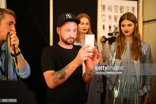 Designer Marcel Ostertag and models are seen backstage ahead of the Marcel Ostertag show during the MercedesBenz Fashion Week Berlin Autumn/Winter...