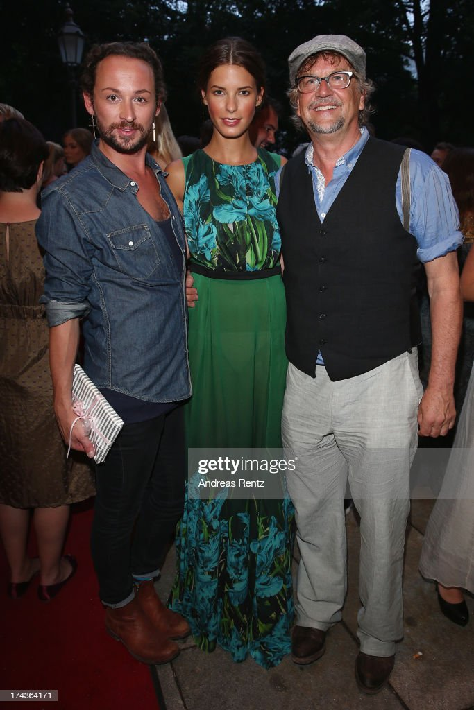 Designer Marcel Ostertag, Julia Trainer and Martin Krug attend the Marcel Ostertag fashion show at Charles Hotel on July 24, 2013 in Munich, Germany.