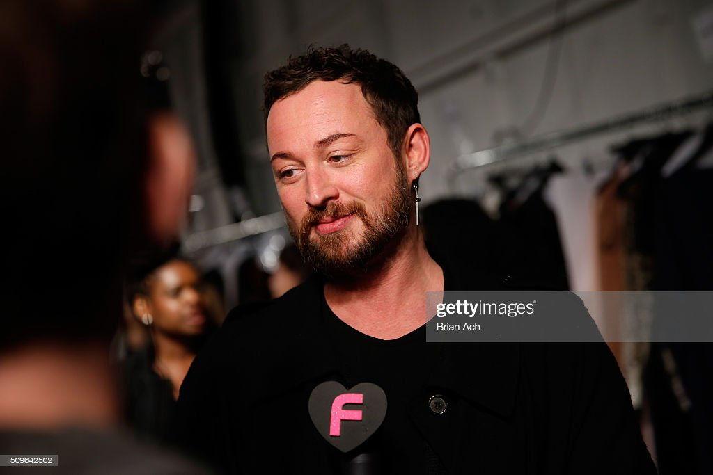 Designer, Marcel Ostertag, poses backstage at Marcel Ostertag Fall 2016 during New York Fashion Week: The Shows at The Gallery, Skylight at Clarkson Square on February 11, 2016 in New York City.