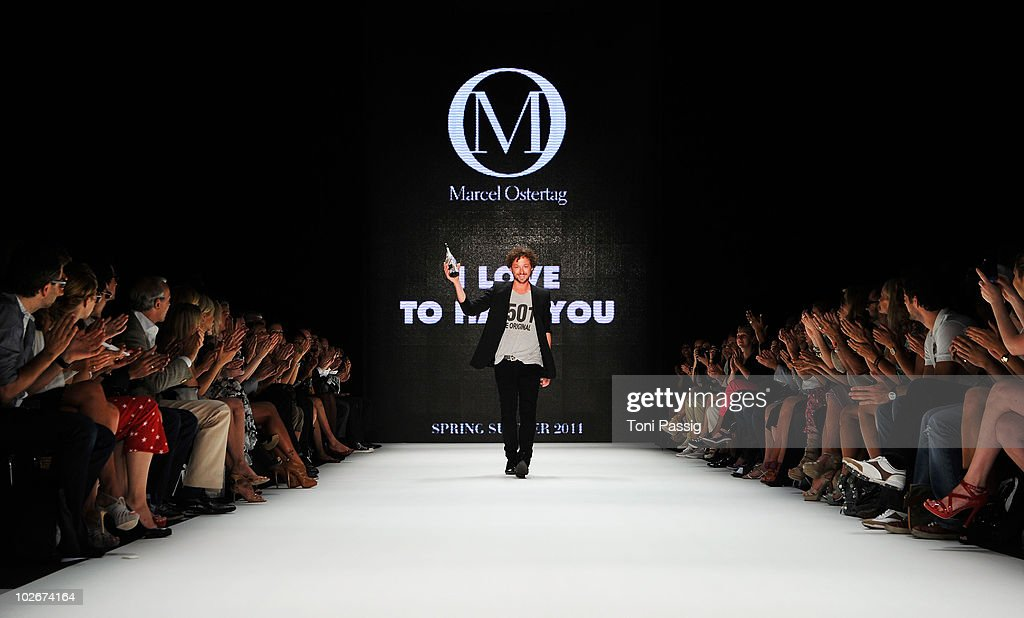 Designer <a gi-track='captionPersonalityLinkClicked' href=/galleries/search?phrase=Marcel+Ostertag+-+Fashion+Designer&family=editorial&specificpeople=4594209 ng-click='$event.stopPropagation()'>Marcel Ostertag</a> poses on the runway at the <a gi-track='captionPersonalityLinkClicked' href=/galleries/search?phrase=Marcel+Ostertag+-+Fashion+Designer&family=editorial&specificpeople=4594209 ng-click='$event.stopPropagation()'>Marcel Ostertag</a> Show during the Mercedes Benz Fashion Week Spring/Summer 2011 at Bebelplatz on July 7, 2010 in Berlin, Germany.