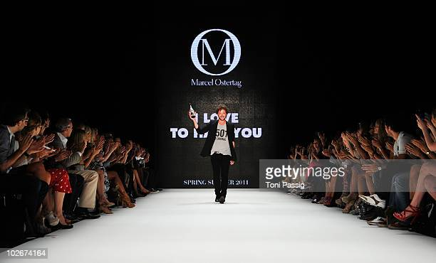 Designer Marcel Ostertag poses on the runway at the Marcel Ostertag Show during the Mercedes Benz Fashion Week Spring/Summer 2011 at Bebelplatz on...