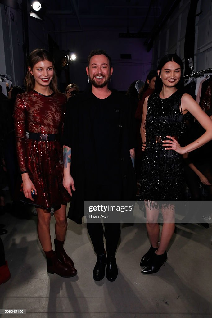 Designer, Marcel Ostertag (center), poses with models backstage at Marcel Ostertag Fall 2016 during New York Fashion Week: The Shows at The Gallery, Skylight at Clarkson Square on February 11, 2016 in New York City.