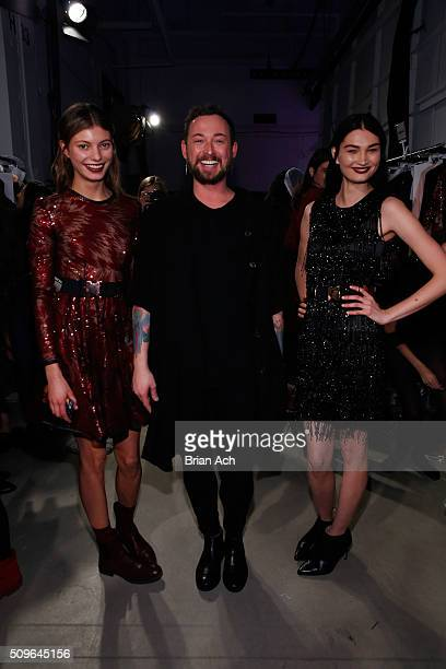 Designer Marcel Ostertag poses with models backstage at Marcel Ostertag Fall 2016 during New York Fashion Week The Shows at The Gallery Skylight at...
