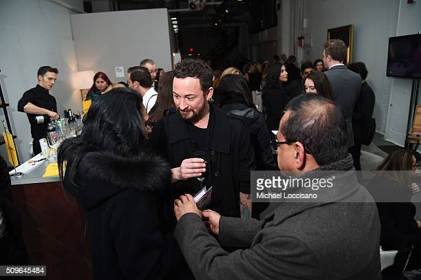 Designer Marcel Ostertag speaks with guests at Marcel Ostertag Fall 2016 during New York Fashion Week The Shows at The Gallery Skylight at Clarkson...