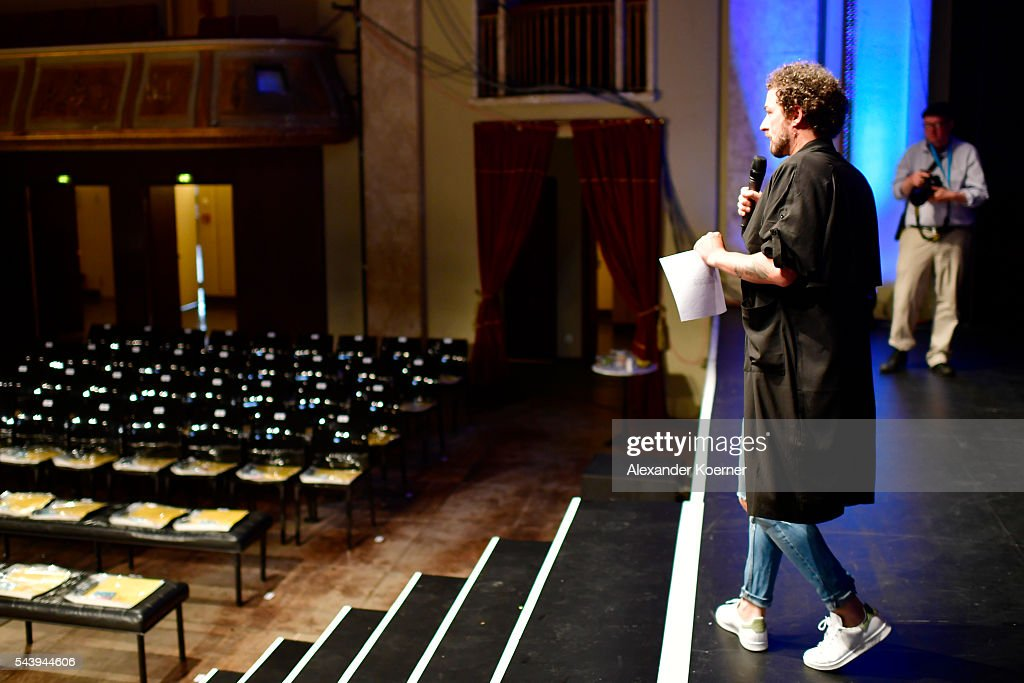 Designer Marcel Ostertag talks to models and team members ahead of his show during the Mercedes-Benz Fashion Week Berlin Spring/Summer 2017 at Admiralspalast on June 30, 2016 in Berlin, Germany.