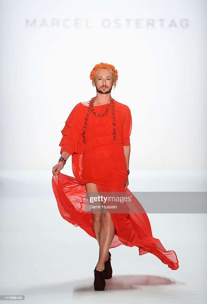 Designer <a gi-track='captionPersonalityLinkClicked' href=/galleries/search?phrase=Marcel+Ostertag+-+Fashion+Designer&family=editorial&specificpeople=4594209 ng-click='$event.stopPropagation()'>Marcel Ostertag</a> walks the catwalk during the <a gi-track='captionPersonalityLinkClicked' href=/galleries/search?phrase=Marcel+Ostertag+-+Fashion+Designer&family=editorial&specificpeople=4594209 ng-click='$event.stopPropagation()'>Marcel Ostertag</a> show at the Mercedes-Benz Fashion Week Spring/Summer 2013 on July 5, 2012 in Berlin, Germany.