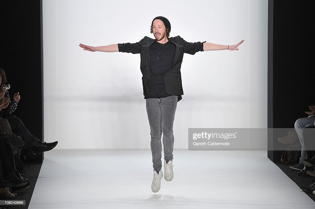 Designer <a gi-track='captionPersonalityLinkClicked' href=/galleries/search?phrase=Marcel+Ostertag+-+Fashion+Designer&family=editorial&specificpeople=4594209 ng-click='$event.stopPropagation()'>Marcel Ostertag</a> walks the runway after the <a gi-track='captionPersonalityLinkClicked' href=/galleries/search?phrase=Marcel+Ostertag+-+Fashion+Designer&family=editorial&specificpeople=4594209 ng-click='$event.stopPropagation()'>Marcel Ostertag</a> Show during the Mercedes Benz Fashion Week Autumn/Winter 2011 at Bebelplatz on January 22, 2011 in Berlin, Germany.