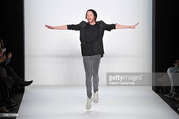 Designer Marcel Ostertag walks the runway after the Marcel Ostertag Show during the Mercedes Benz Fashion Week Autumn/Winter 2011 at Bebelplatz on...
