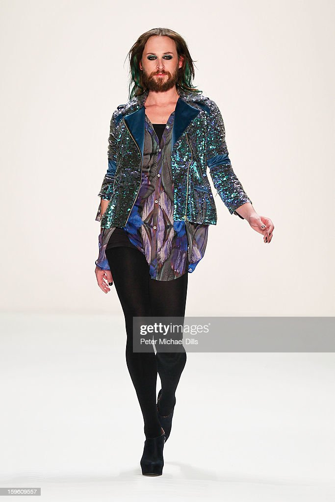 Designer <a gi-track='captionPersonalityLinkClicked' href=/galleries/search?phrase=Marcel+Ostertag+-+Fashion+Designer&family=editorial&specificpeople=4594209 ng-click='$event.stopPropagation()'>Marcel Ostertag</a> walks the runway at <a gi-track='captionPersonalityLinkClicked' href=/galleries/search?phrase=Marcel+Ostertag+-+Fashion+Designer&family=editorial&specificpeople=4594209 ng-click='$event.stopPropagation()'>Marcel Ostertag</a> Autumn/Winter 2013/14 fashion show during Mercedes-Benz Fashion Week Berlin at Brandenburg Gate on January 17, 2013 in Berlin, Germany.