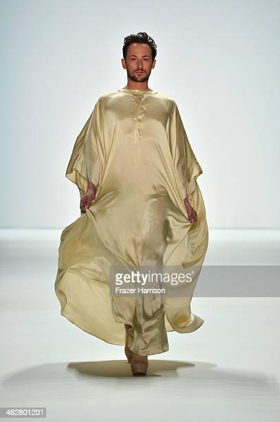 Designer Marcel Ostertag walks the runway at the Marcel Ostertag show during MercedesBenz Fashion Week Autumn/Winter 2014/15 at Brandenburg Gate on...
