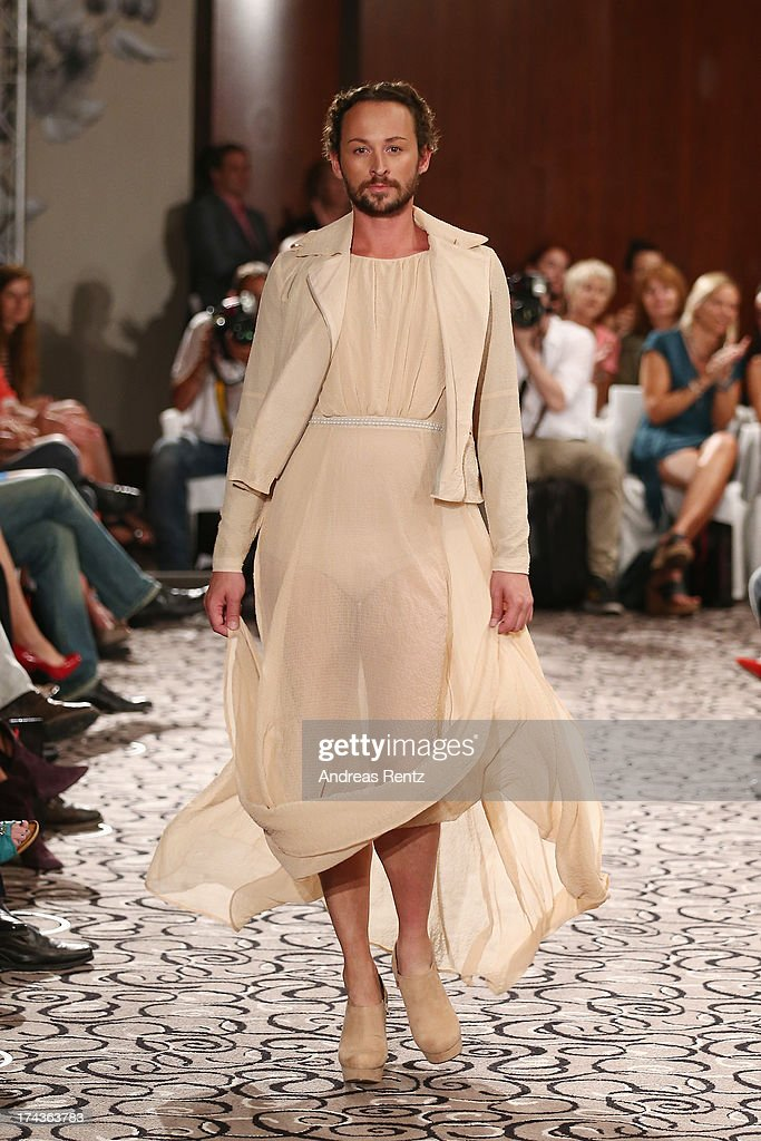 Designer Marcel Ostertag walks the runway during the Marcel Ostertag fashion show at Charles Hotel on July 24, 2013 in Munich, Germany.