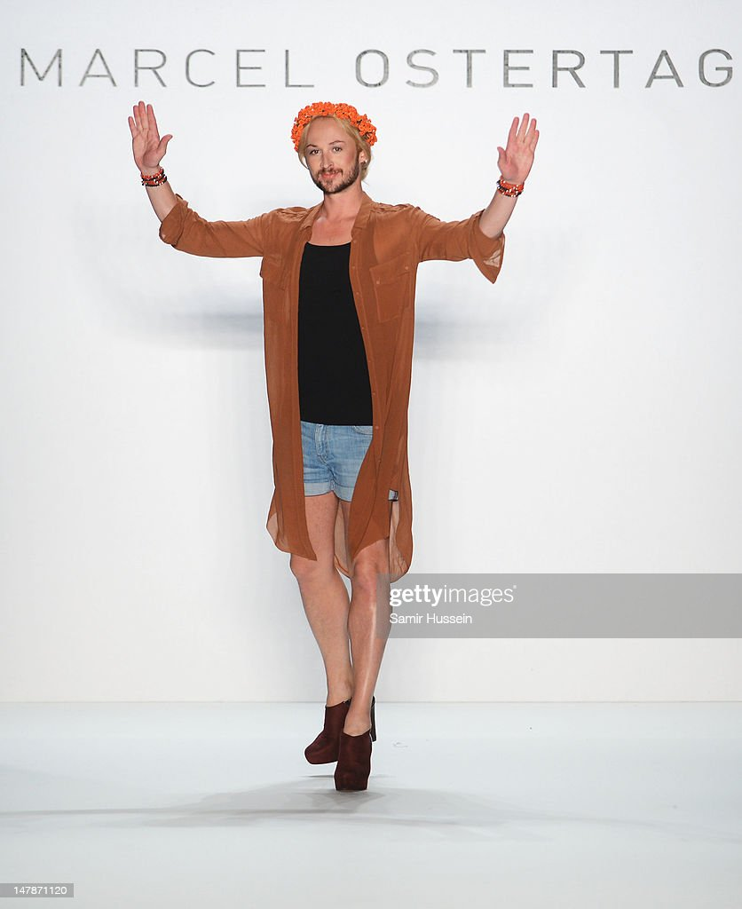 Designer <a gi-track='captionPersonalityLinkClicked' href=/galleries/search?phrase=Marcel+Ostertag+-+Fashion+Designer&family=editorial&specificpeople=4594209 ng-click='$event.stopPropagation()'>Marcel Ostertag</a> waves to the audience after the <a gi-track='captionPersonalityLinkClicked' href=/galleries/search?phrase=Marcel+Ostertag+-+Fashion+Designer&family=editorial&specificpeople=4594209 ng-click='$event.stopPropagation()'>Marcel Ostertag</a> show at the Mercedes-Benz Fashion Week Spring/Summer 2013 on July 5, 2012 in Berlin, Germany.