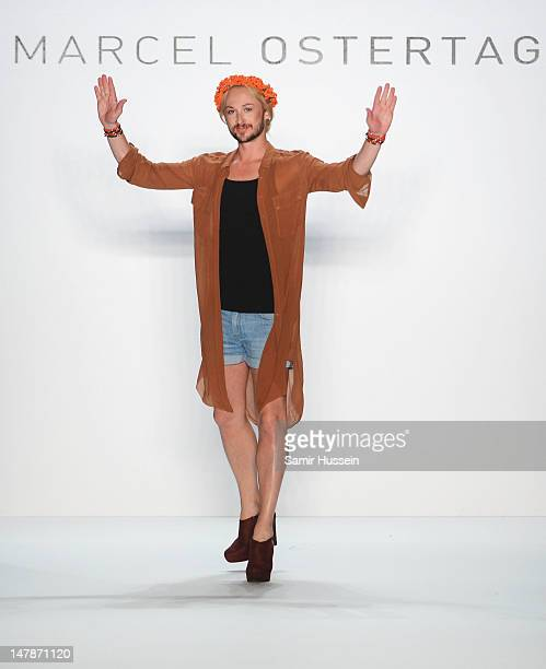 Designer Marcel Ostertag waves to the audience after the Marcel Ostertag show at the MercedesBenz Fashion Week Spring/Summer 2013 on July 5 2012 in...