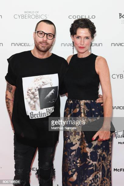 Designer Marcell Von Berlin and Julia Bremermann are seen during the Marcell Von Berlin 'Genesis' collection presentation on July 3 2017 in Berlin...
