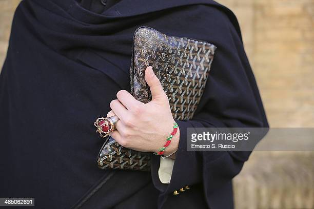 Designer Marco Ferra wears Goyard bag Hermes coat and cape on day 2 Rome Fashion Week Spring/Summer 2014 on January 23 2014 in Parisin Rome Italy