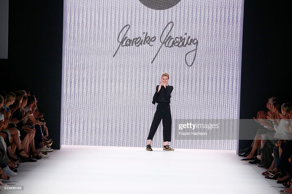 Designer Mareike Massing acknowledges the applause of the audience after her show at 'Designer for Tomorrow' by Peek & Cloppenburg and Fashion ID, during the Mercedes-Benz Fashion Week Berlin Spring/Summer 2017 at Erika Hess Eisstadion on June 30, 2016 in Berlin, Germany.