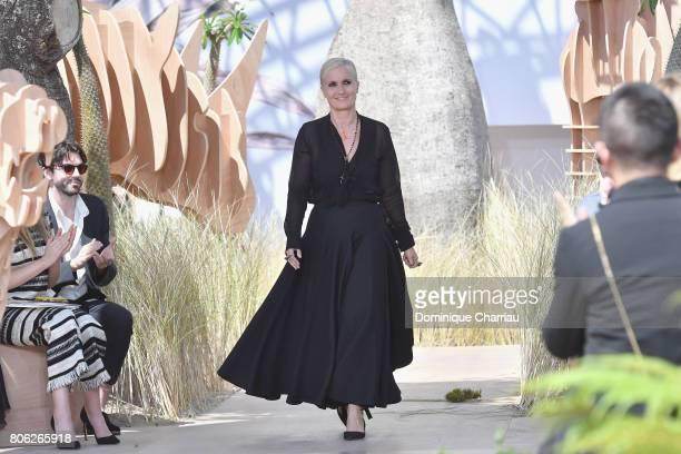 Designer Maria Grazia Chiuri walks the runway during the Christian Dior Haute Couture Fall/Winter 20172018 show as part of Haute Couture Paris...