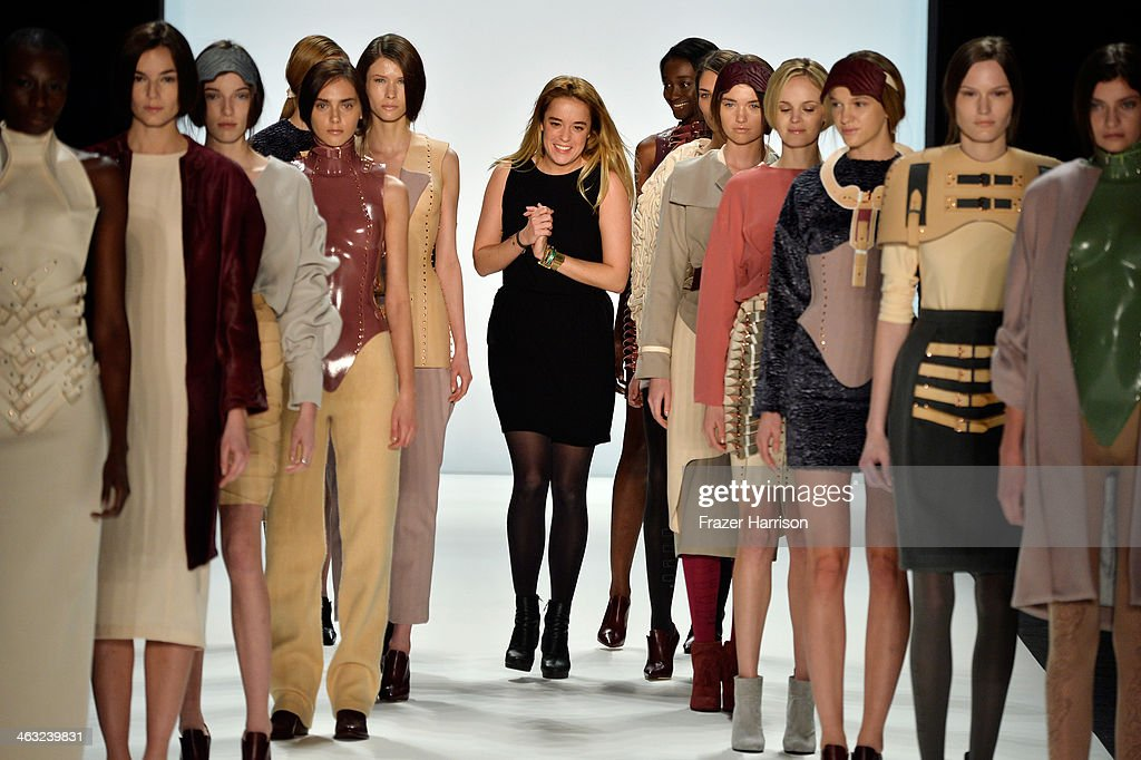 Designer Marina Hoermanseder acknowledges the audience after the Marina Hoermanseder show during Mercedes-Benz Fashion Week Autumn/Winter 2014/15 at Brandenburg Gate on January 17, 2014 in Berlin, Germany.