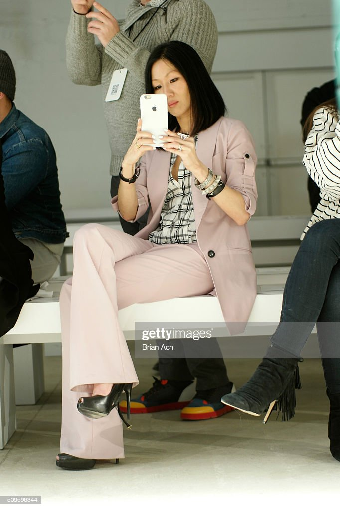 Designer, Marissa Webb, takes a photo with her phone at the Marissa Webb Fall 2016 fashion show during New York Fashion Week: The Shows at The Gallery, Skylight at Clarkson Square on February 11, 2016 in New York City.