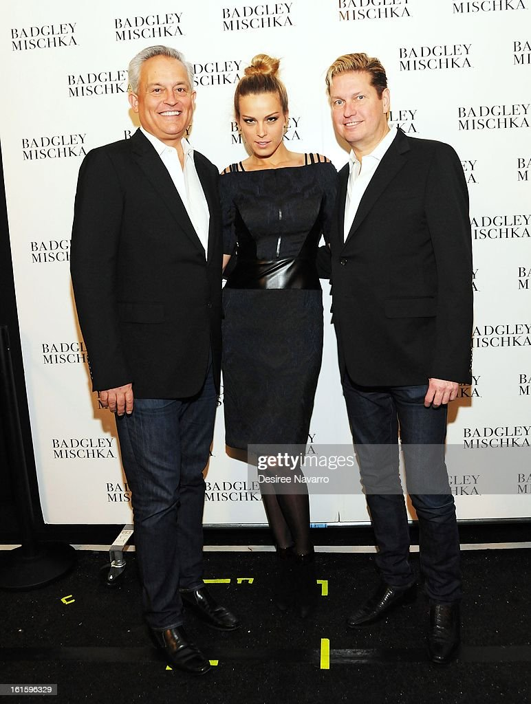 Designer Mark Badgley, model <a gi-track='captionPersonalityLinkClicked' href=/galleries/search?phrase=Petra+Nemcova&family=editorial&specificpeople=201716 ng-click='$event.stopPropagation()'>Petra Nemcova</a> and designer <a gi-track='captionPersonalityLinkClicked' href=/galleries/search?phrase=James+Mischka&family=editorial&specificpeople=642521 ng-click='$event.stopPropagation()'>James Mischka</a> pose backstage for a photo at Badgley Mischka during Fall 2013 Mercedes-Benz Fashion Week at The Theatre at Lincoln Center on February 12, 2013 in New York City.
