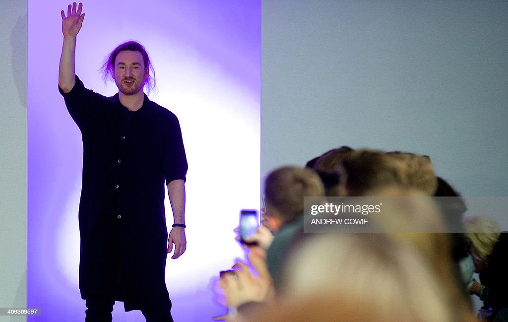 Designer Mark Fast thanks the audience at the end of his show during the 2014 Autumn / Winter London Fashion Week in London on February 14 2014 AFP...