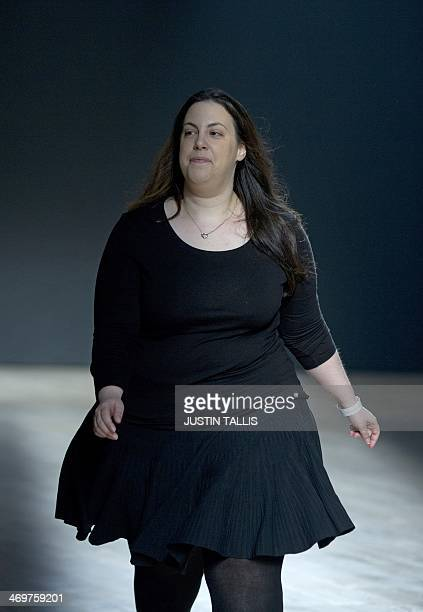 Designer Mary Katrantzou smiles after her show during the 2014 Autumn / Winter London Fashion Week in London on February 16 2014 AFP PHOTO / JUSTIN...