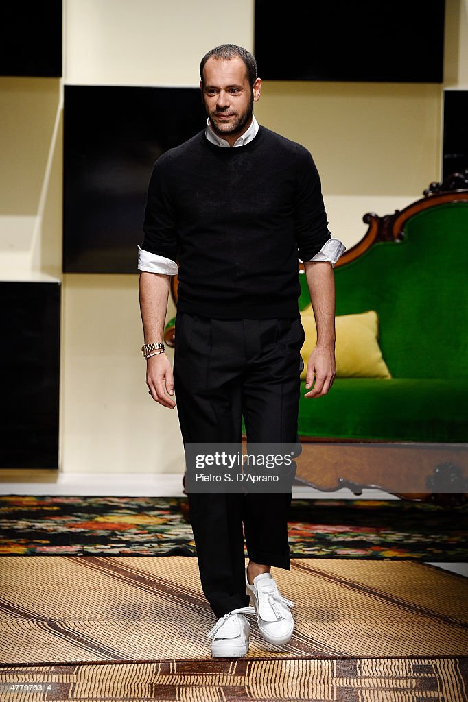 Designer Massimiliano Giornetti acknowledges the applause of the audience after the Salvatore Ferragamo fashion show as part of Milan Men's Fashion Week Spring/Summer 2016 on June 21, 2015 in Milan, Italy.
