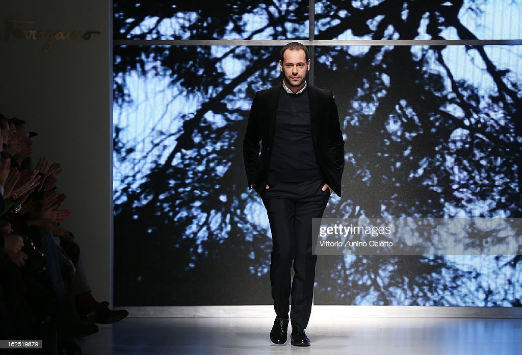 Designer <a gi-track='captionPersonalityLinkClicked' href=/galleries/search?phrase=Massimiliano+Giornetti&family=editorial&specificpeople=3951751 ng-click='$event.stopPropagation()'>Massimiliano Giornetti</a> acknowledges the audience at the Salvatore Ferragamo fashion show as part of Milan Fashion Week Womenswear Fall/Winter 2013/14 on February 24, 2014 in Milan, Italy.
