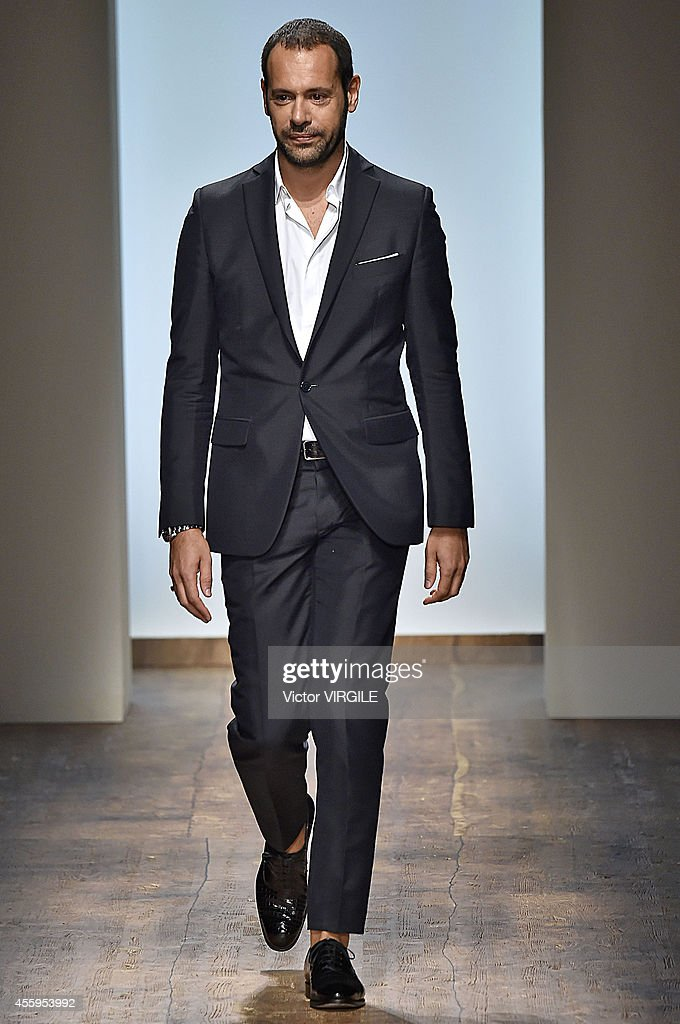 Designer <a gi-track='captionPersonalityLinkClicked' href=/galleries/search?phrase=Massimiliano+Giornetti&family=editorial&specificpeople=3951751 ng-click='$event.stopPropagation()'>Massimiliano Giornetti</a> during the Salvatore Ferragamo Ready to Wear show as a part of the Milan Fashion Week Womenswear Spring/Summer 2015 on September 21, 2014 in Milan, Italy.