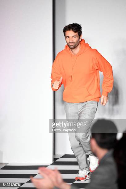 Designer Massimo Giorgetti acknowledges the applause of the audience at the MSGM show during Milan Fashion Week Fall/Winter 2017/18 on February 26...
