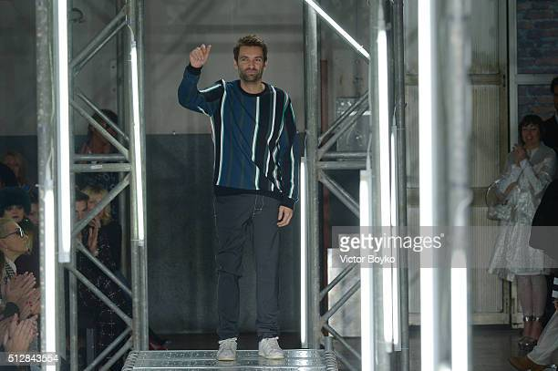 Designer Massimo Giorgetti ackowledges the applause of the audience at the end of MSGM show during Milan Fashion Week Fall/Winter 2016/17 on February...