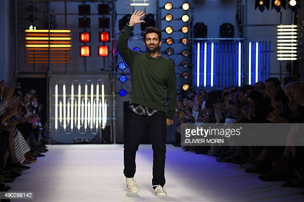 Designer Massimo Giorgetti greets the audience at the end of the show for fashion house MSGM during the women Spring / Summer 2016 Milan's Fashion...